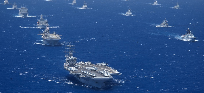 Ships and submarines participating in the 2012 Rim of the Pacific exercise stay in close formation during one part of the exercise.