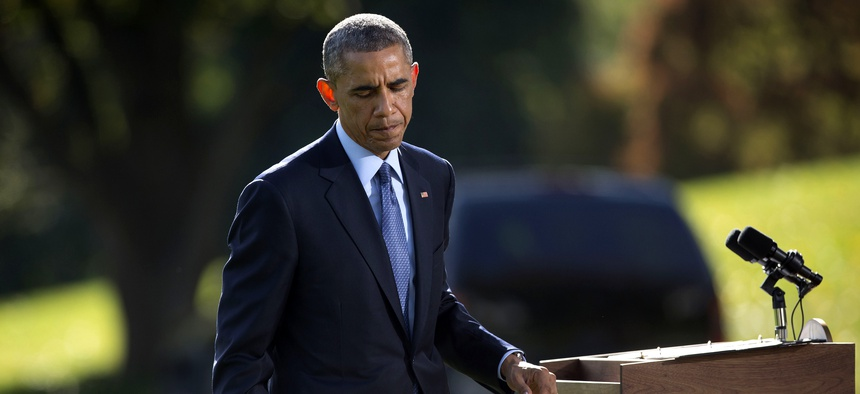 President Obama walks away from the podium after speaking about Ebola from the South Lawn of the White House on the Ebola crisis, on October 28, 2014.
