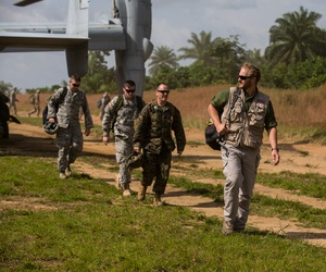 U.S. military personnel disembark a U.S. Marine Corps MV-22B Osprey to conduct site surveys during Operation United Assistance in Ganta, Liberia, Oct 22, 2014.