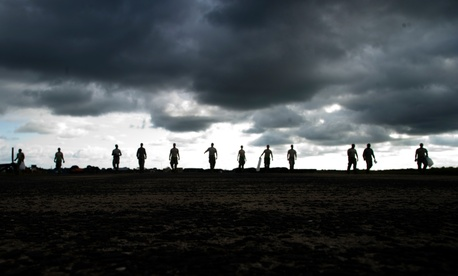 U.S. Airmen with the 621st Contingency Response Wing conduct a foreign object debris walk in Monrovia, Liberia, during Operation United Assistance Oct. 28, 2014.