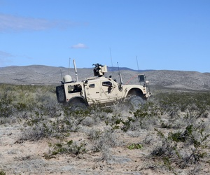Soldiers from 2nd Brigade, 1st Armored Division drive a vehicle equipped with Warfighter Information Network-Tactical (WIN-T) Increment 2 during the Army's Network Integration Evaluation (NIE) 13.1 on Nov. 9, 2012.