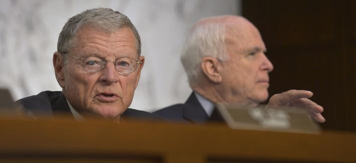 Sen. Jim Inhofe, R-Okla., and Sen. John McCain, R-Ariz., attend a Senate Armed Services Committee hearing on Sept. 16, 2014.