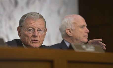 Sen. Jim Inhofe, R-Okla., and Sen. John McCain, R-Ariz., attend a Senate Armed Services Committee hearing on Sept. 16, 2014.