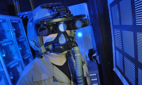 Tech. Sgt. Matthew Freeman does an operational check of panoramic night vision goggles at a deployed location in March 2006.