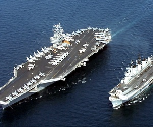 The U.S. Navy aircraft carrier USS John C. Stennis (CVN-74) (left), steams alongside the British Royal Navy aircraft carrier HMS Illustrious (R 06) in the Persian Gulf in 1998.
