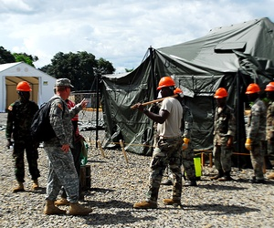 U.S. Army Africa soldiers work with Liberian military engineers on an Ebola treatment unit in Tubmanburg, Liberia.