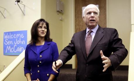 Arizona Sen. John McCain stands with Senate Candidate Monica Wehby (left) during a campaign event on October 2, 2014.
