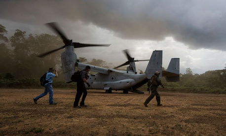 An MV-22 Osprey with the SPMAGTF Crisis Response - Africa, drops off supplies to support Operation United Assistance, in Fish Town, Liberia.