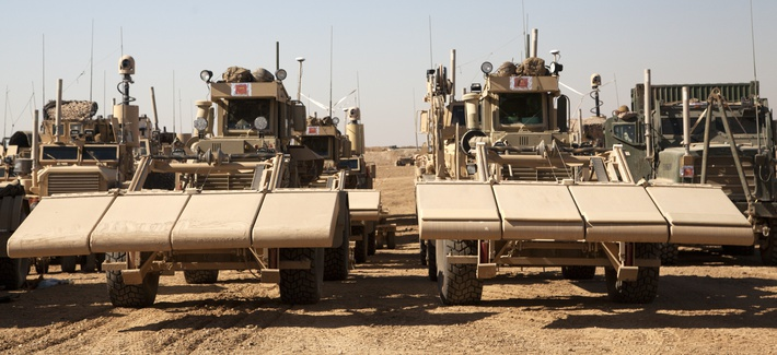 Two U.S. Marine Corps Husky mine detection vehicles staged to lead a route clearance mission in in Helmand Province, Afghanistan.