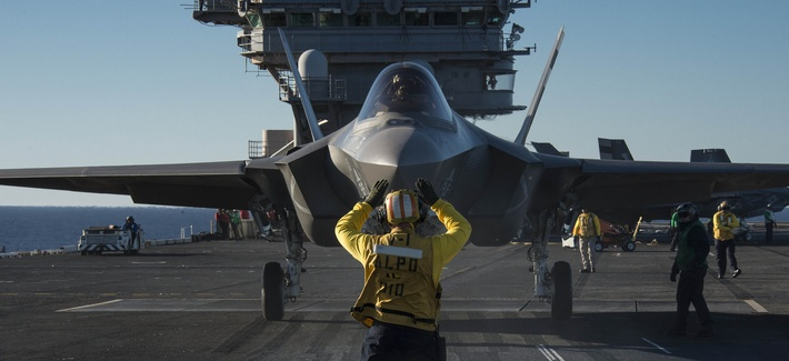 An F-35C Lightning II carrier variant joint strike fighter is prepared for launch aboard the aircraft carrier USS Nimitz, on Nov. 4, 2014.