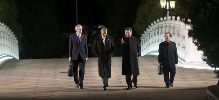 President Obama walks with China's President Xi Jinping at the Zhongnanhai leaders compound before a private dinner, on November 11, 2014.