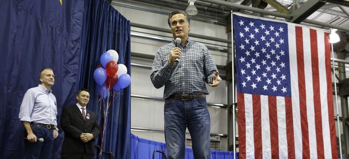 Former Republican presidential candidate Mitt Romney, center, speaks at a rally for Senate candidate Dan Sullivan, on November 3, 2014.