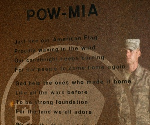 U.S. Air Force Staff Sgt. Dylan Peterson stands at attention in front of the Prisoners of War/Missing in Action Memorial at Heritage Park Sept. 29, 2011, as part of the 2011 POW/MIA Recognition Day.