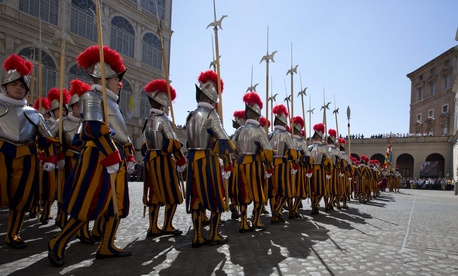 Vatican Swiss guards march prior to a swearing-in ceremony at the Vatican, on MAy 6, 2014.