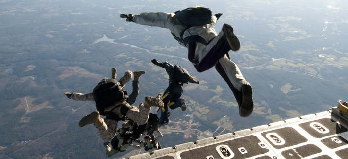 U.S. Navy SEALs exit a C-130 Hercules aircraft during a training exercise near Fort Pickett, Va.