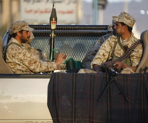 Houthi Shiite Yemenis wearing army uniforms ride on a pickup truck during a street patrol in Sanaa, Yemen, on October 31, 2014.