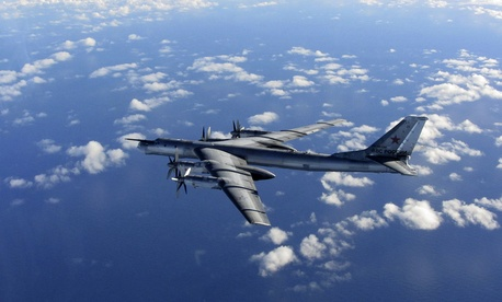 A Russian long range bomber aircraft is intercepted by a British Royal Air Force jet, on October 29, 2014.