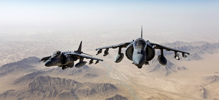 Two AV-8B Harrier jets with Marine Attack Squadron 311 fly over Helmand province, Afghanistan, on June 10, 2013