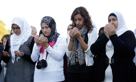 Attendees pray at a vigil for Abdul-Rahman Kassig, who last week was named the next beheading target of the Islamic State terror group, at Butler University, Wednesday, Oct. 8, 2014 in Indianapolis.