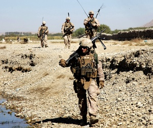 Marines with the 7th Marine Regiment patrol near FOB Musa Qala, Helmand province, on October 19, 2013.