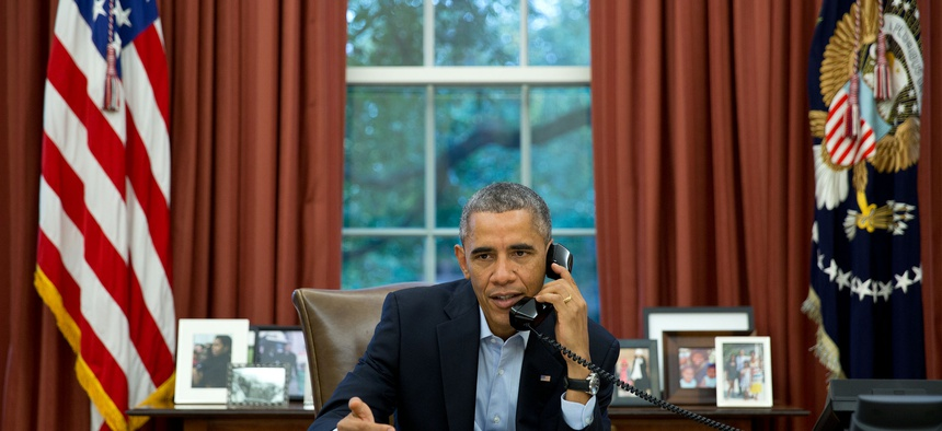 President Obama speaks on a conference call with service members in LIberia and Senegal, on November 1, 2014.