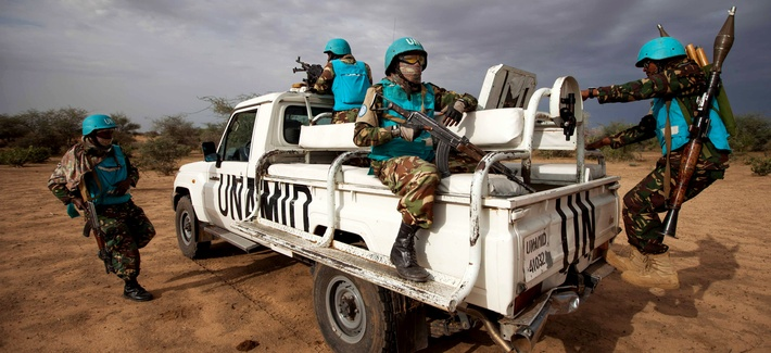 Tanzanian United Nations African Union Mission in Darfur (UNAMID) troops patrol Khor Abeche, South Darfur, Sudan, July 1, 2014.