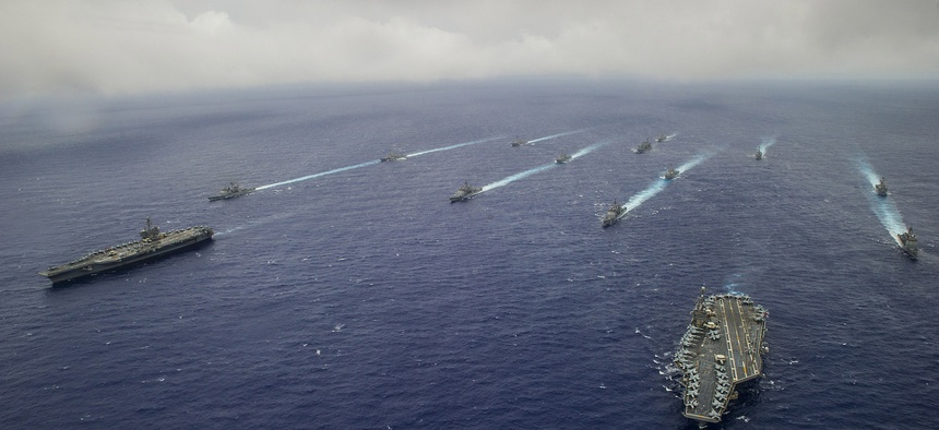 Ships from the George Washington and Carl Vinson Carrier Strike Groups are underway in formation at the conclusion of Valiant Shield 2014