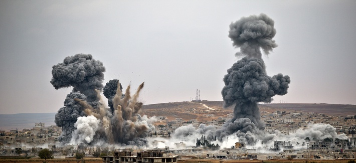 Smoke rises from the Syrian border town of Kobani, after air strikes were conducted by U.S. led coalition forces.