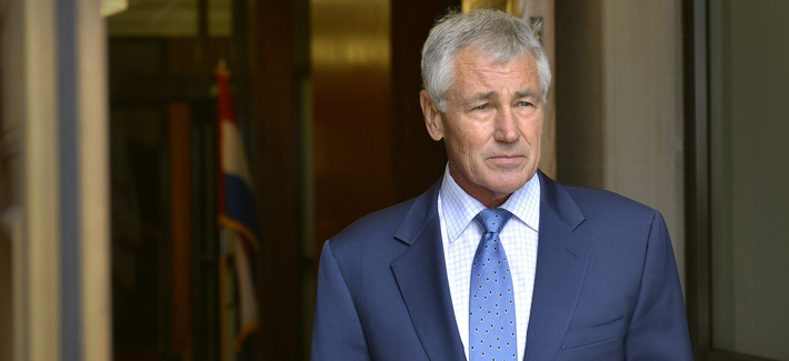 Defense Secretary Chuck Hagel waits for the arrival of Minister of Defense of the Netherlands Jeanine Hennis-Plasschaert, on October 7, 2014.