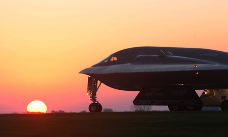 A B-2 Spirit bomber taxis on a flightline, on October 26, 2014.