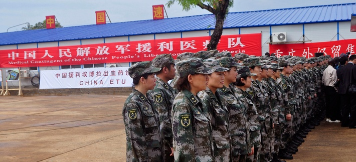 Chinese soldiers stand parade during the opening of a new Ebola virus clinic sponsored by China, in Monrovia, Liberia, on Nov. 25, 2014,