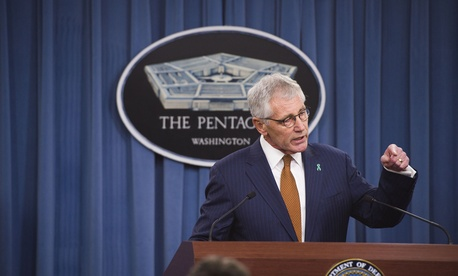 Defense Secretary Chuck Hagel speaks to reporters at the Pentagon, on December 4, 2014.