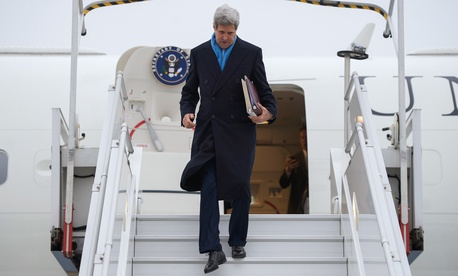 Secretary of State John Kerry disembarks from his Air Force jet after arriving in Paris, France, on November 20, 2014.