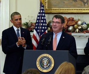 President Obama and Vice President Joe Biden applaud as Ashton Carter, the administration's nominee for defense secretary, speaks at the White House, on December 5, 2014.