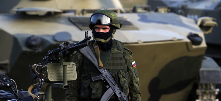 A Russian paratrooper stands guard during the Russian-Serbian joint antiterrorist exercise Srem 2014, at Nikinci training ground, 60 kilometers west of Belgrade, Serbia, Friday, Nov. 14, 2014.