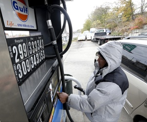 An employee at a Gulf gas station in New Jersey City, N.J., pumps gas, on November 12, 2013,