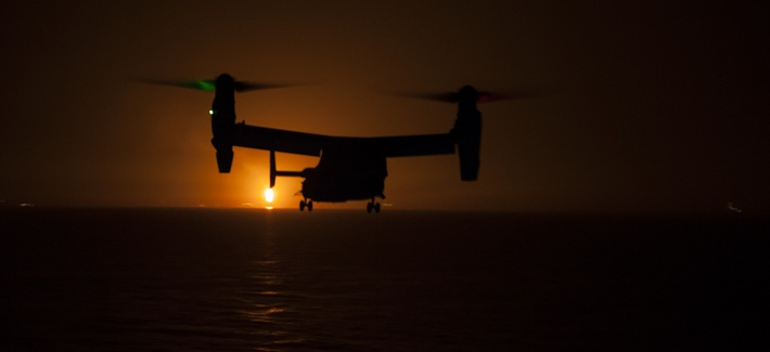 A MV-22 Osprey prepares to land aboard the amphibious assault ship USS Makin Island during night vision device flight operations on Sept. 17.
