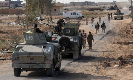 Iraqi security forces are deployed during a military operation to control the villages around the town of Beiji, 250 kilometers north of Baghdad, on December 8, 2014.