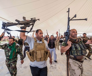 An Iraqi volunteer force chants slogans against ISIS during training in the Shiite holy city of Karbala.