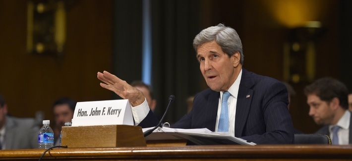 Secretary of State John Kerry testifies on Capitol Hill before the Senate Foreign Relations Committee on procuring an AUMF to combat ISIS, on December 9, 2014.