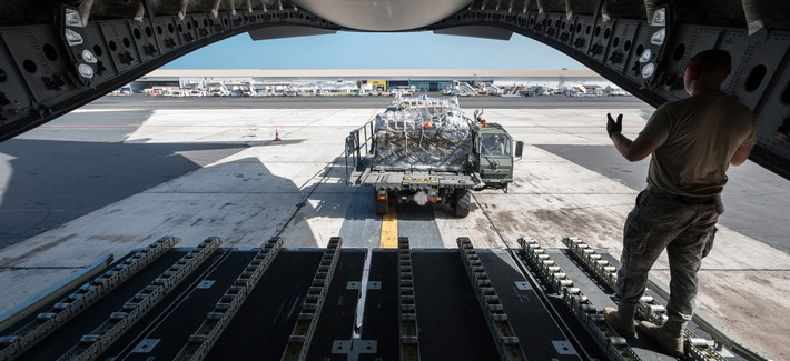 U.S. airmen from the Kentucky Air National Guard offload cargo pallets from a C-17 Globemaster III aircraft at Leopold Sedar Senghor International Airport in Dakar, Senegal, Oct. 18, 2014, to support the fight against Ebola in West Africa.