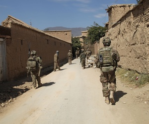 A group of U.S. soldiers from Apache Troop 1/7th Cavalry Battalion walk through an alley during a security foot patrol in Parwan province, AFghanistan.