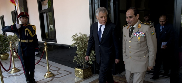 Defense Secretary Chuck Hagel walks with then Egyptian Minister of Defense Abdel Fattah al-Sisi during a visit to Cairo, on April 24, 2013.