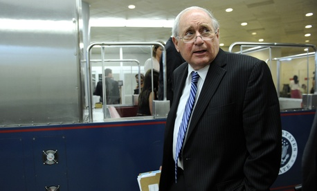 Senate Armed Services Committee Chairman Sen. Carl Levin walks to a train on Capitol Hill after a committee hearing, on July 8, 2014.
