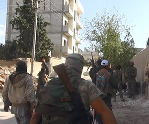 Islamic State fighters walk through the streets of Kobani, on November 4, 2014.