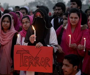 Pakistani students participate in a candle light vigil for victims killed in a Taliban attack on a military-run school in Islamabad, Pakistan, Wednesday, Dec. 17, 2014.