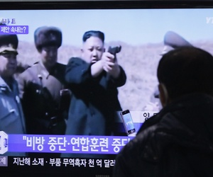 A man watches a TV news program showing North Korean leader Kim Jong-un at the Seoul Railway Station in Seoul, South Korea.