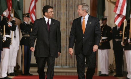 President Bush walks with Pakistan's President Gen. Pervez Musharraf, on September 22, 2006.