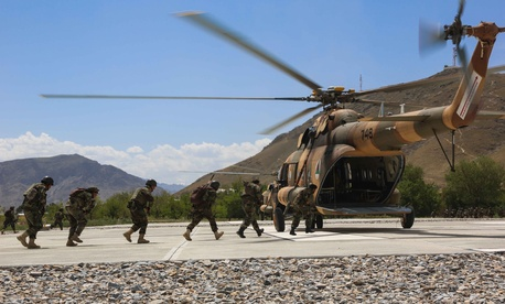 Afghan National Army Special Forces and commandos, from 6th Special Operations Kandak, load onto a Mi17 helicopter from Special Missions Wing unit while conducting mission readiness training, near Kabul province, Afghanistan, May 29, 2014.
