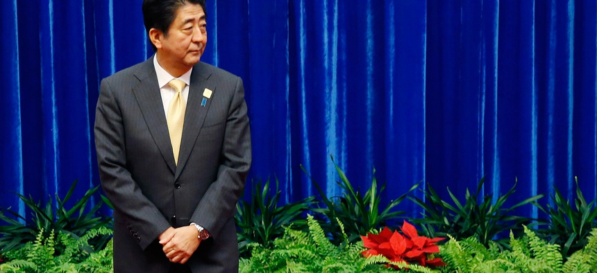 Japan's Prime Minister Shinzo Abe waits to meet China's President Xi Jinping during their meeting at the Great Hall of the People, on the sidelines of the Asia Pacific Economic Cooperation (APEC) meetings, in Beijing, Nov. 10, 2014.